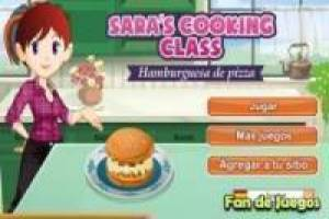 Sara`s cooking a delicious pizza with hamburger